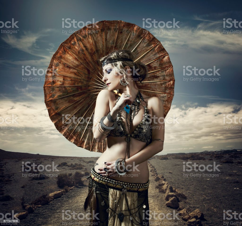 Tribal dancer with parasol stock photo