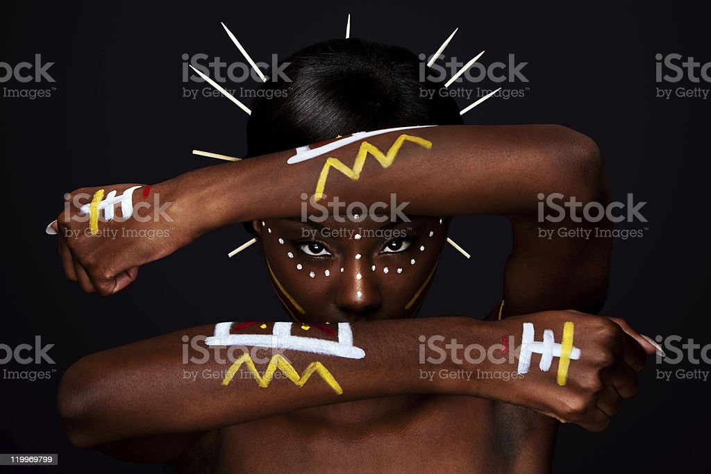 Tribal face and arms hands stock photo