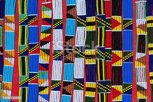 Tribal masai colorful bracelets for sale for tourists at the beach market, close up. Island of Zanzibar, Tanzania, East Africa