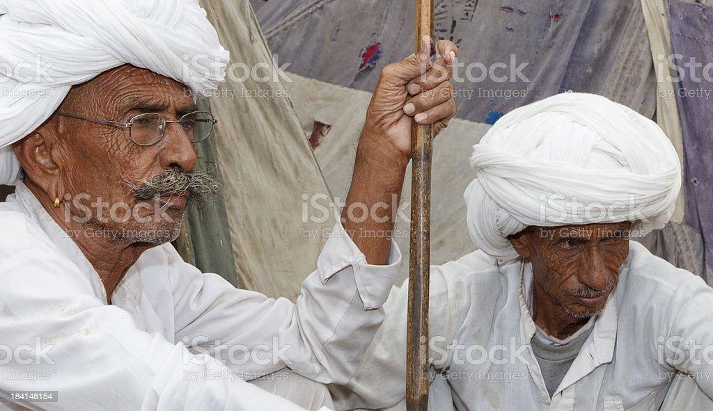 Tribal men in white Pushkar Rajasthan India stock photo