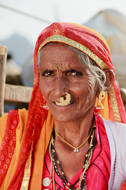 Tribal senior woman with gold nose ring Rajasthan India stock photo