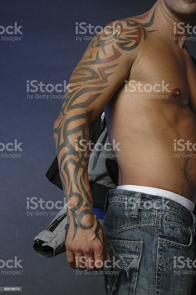 Tribal tatto on arm stock photo
