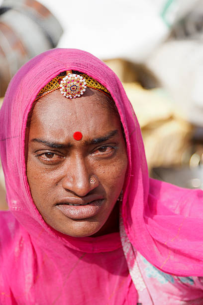 Tribal woman in pink sari Pushkar Rajasthan India stock photo