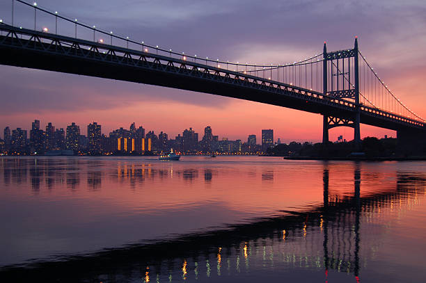 Triboro bridge silhouette at sunset stock photo