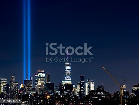 Tribute in light and the One World Trade downtown Manhattan skyline at night in New York City.