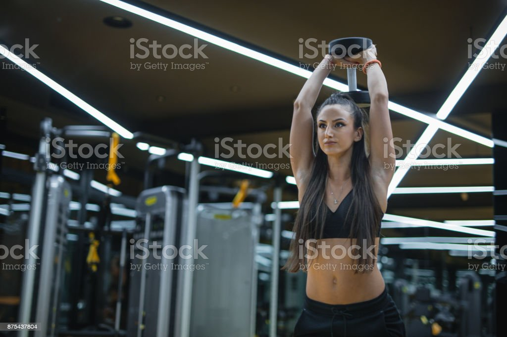 Triceps workout in a gym by a female stock photo