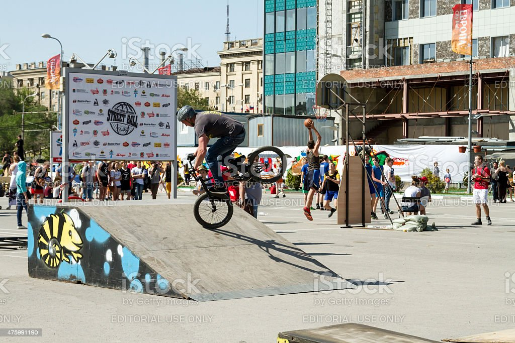 The athlete is an extreme sports enthusiast performs a trick on a BMX...