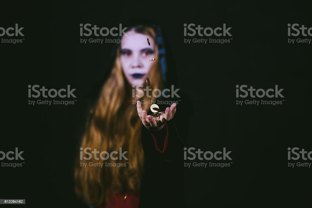 Trick or Treat? This Evil Vampire Offers Money stock photo