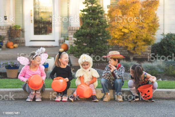 Trick or treaters sitting on a curb picture id1169657481?b=1&k=6&m=1169657481&s=612x612&h=shzc6ixw8fj64 az2tfz0 9rupnxj2tcjp1xf2hlqni=