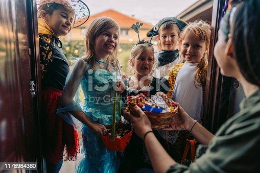 istock Trick or treating 1178984360