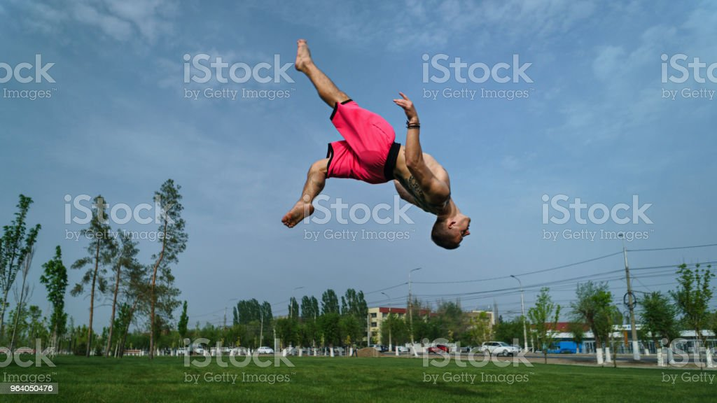 Tricking on lawn in park - Royalty-free Acrobat Stock Photo