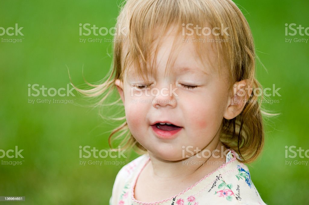 Tricky Toddler Blink stock photo