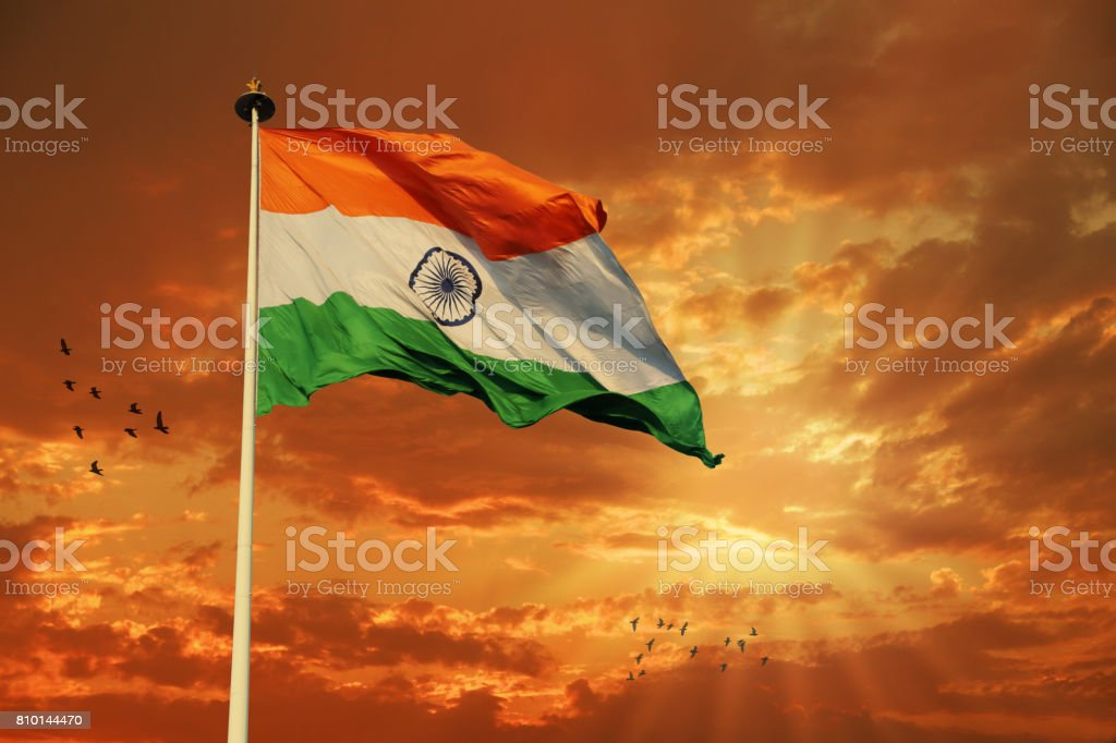 Tricolor Indian Flag during Sunset and beautiful sky stock photo
