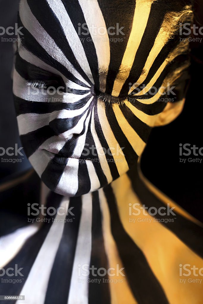 Tricolor spiral bodyart on the body of a young girl stock photo