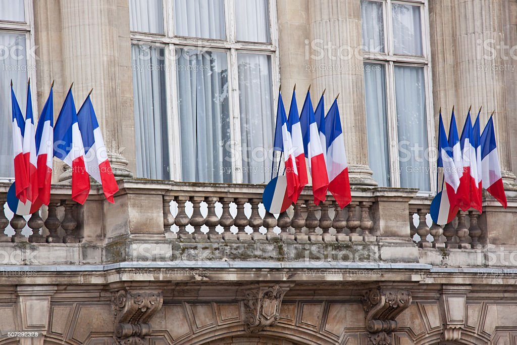 Tricolours adorn a French government building on Bastille Day stock photo