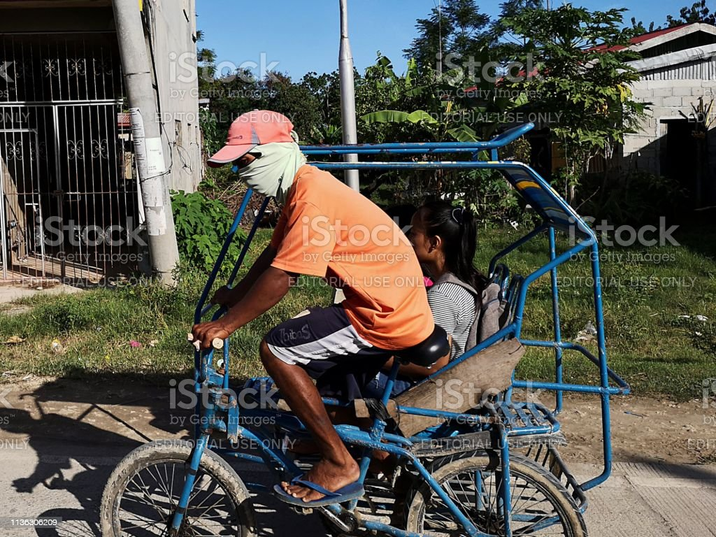 Tricycle rider, Bogo city, Cebu, Philippines stock photo
