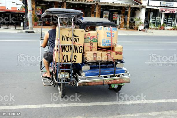 Tricycle with food supplies cross an empty road during the lockdown picture id1219080145?b=1&k=6&m=1219080145&s=612x612&h=d1lv64verbym6gu3 o6vsbtltkvxeu8mcnynodmmgvy=