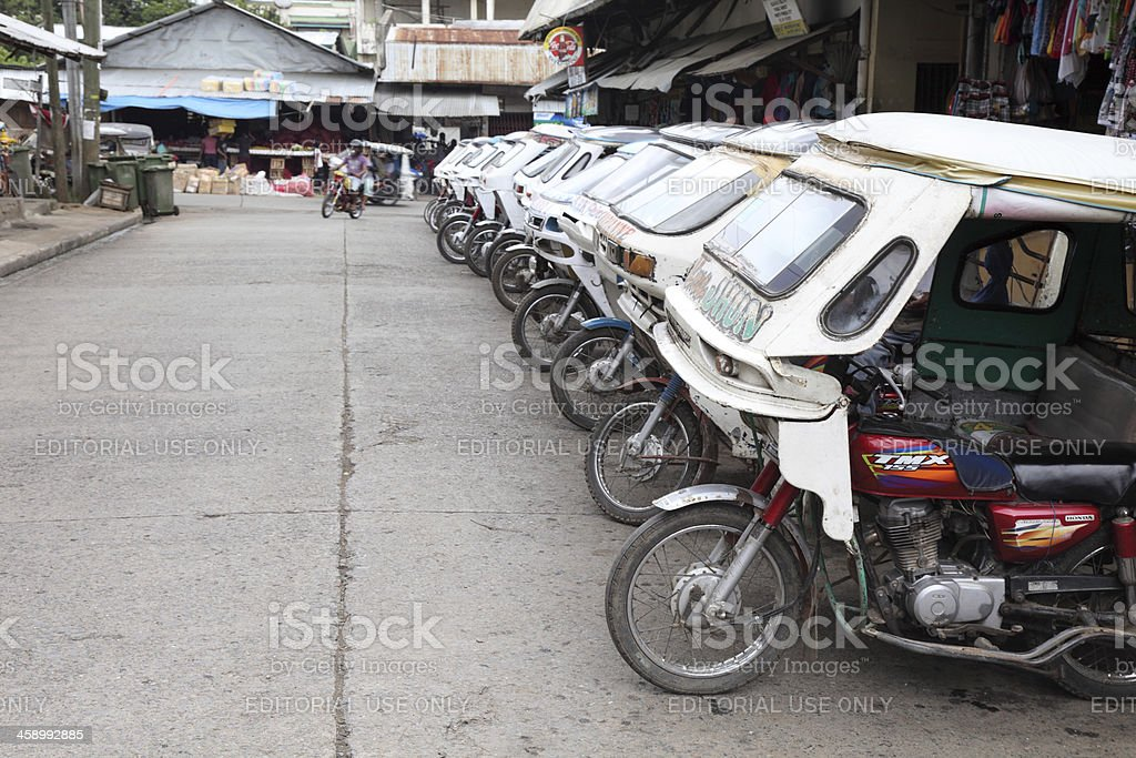 Tricycles parked on the streets of Puerto Princesa royalty-free stock photo