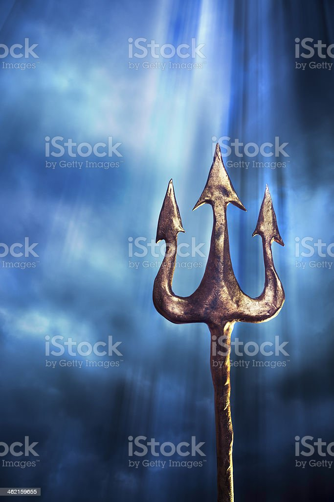 trident on a dramatic background stock photo