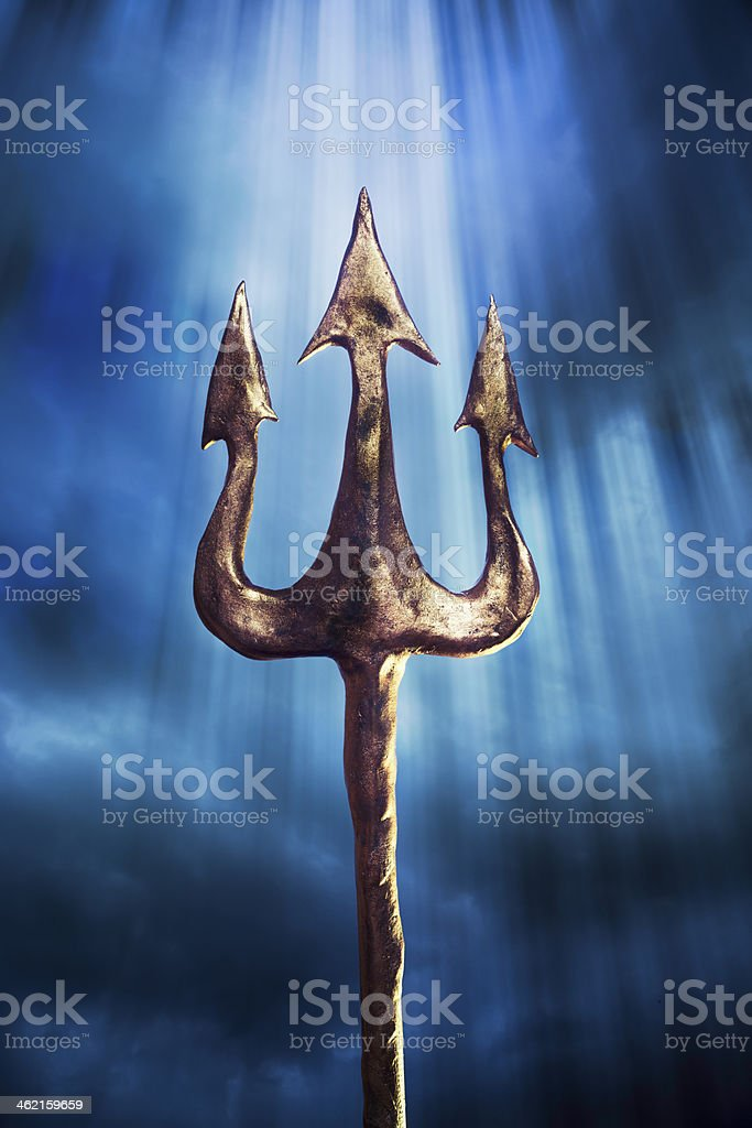 trident on a dramatic background royalty-free stock photo