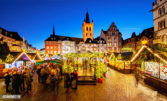 View over Trier´s main square and christmas market at dusk. Trier, located in Rheinland-Pfalz is German oldest city and looks back at 2000 years of history. Trier lies at scenic Mosel River Valley and near the border of Luxembourg.