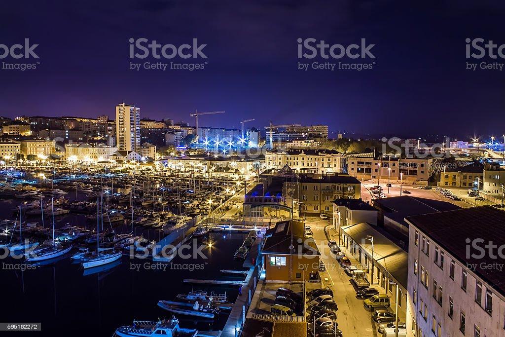 Trieste harbor by night stock photo