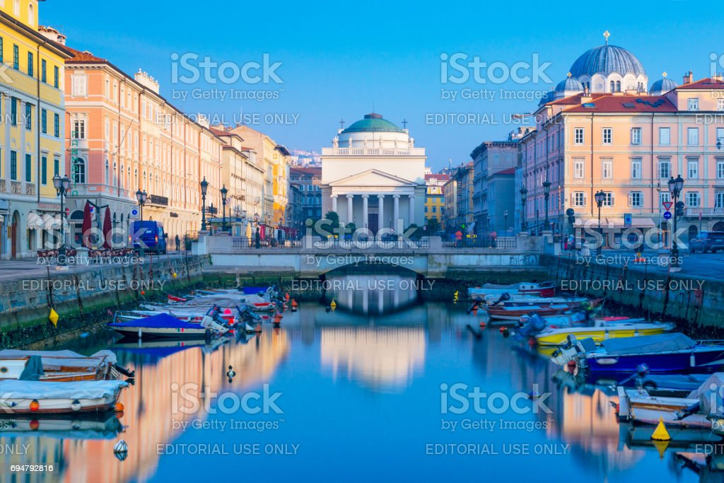Trieste, Italy: View of Grand Canal in Trieste, city reflected in the water, long exposure photography stock photo
