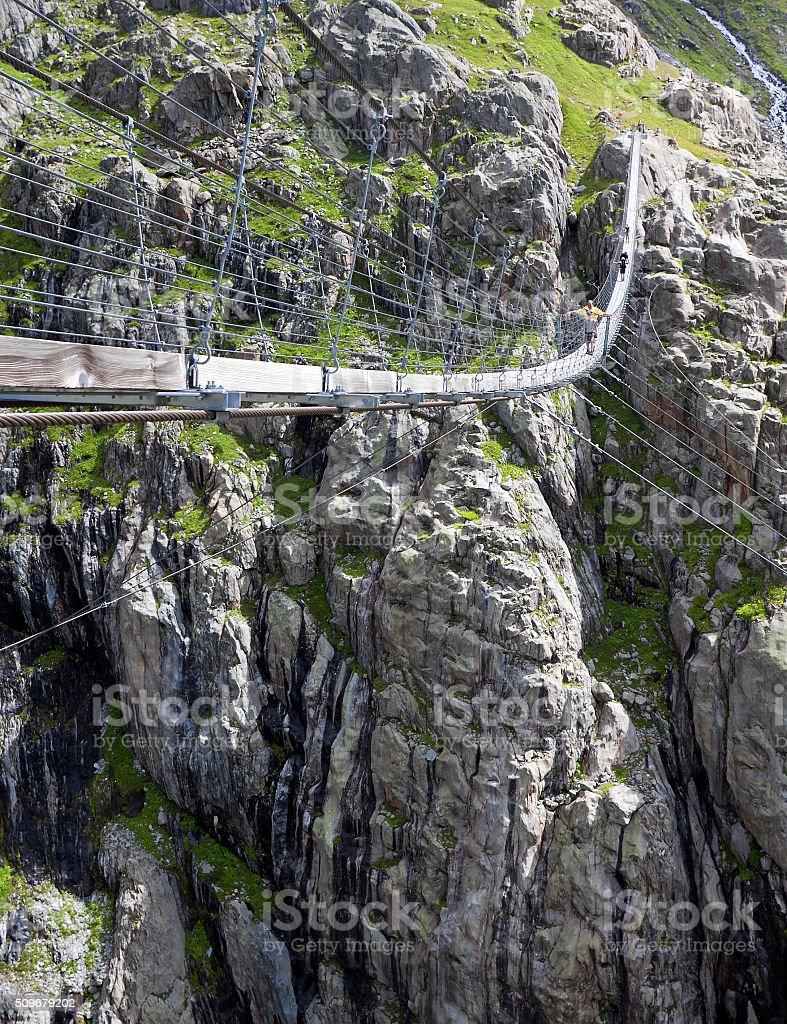Trift Bridge, pedestrian-only suspension bridge in Alps. Svitzerland stock photo