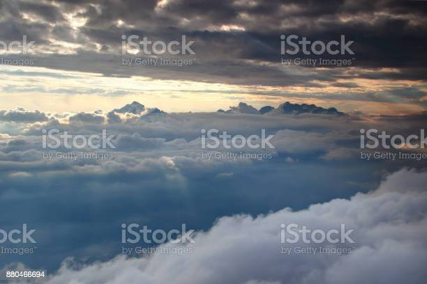 Photo of Triglav and jagged snowy peaks of Julian Alps above cloud cover