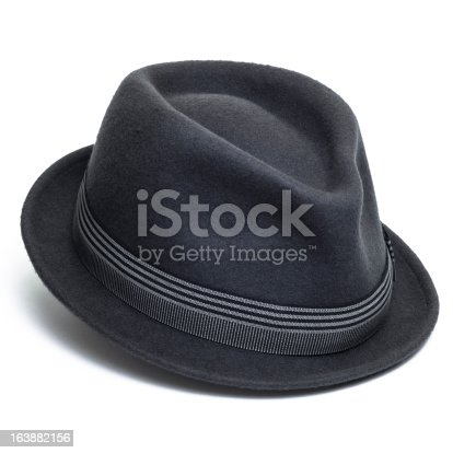 Grey felt trilby/fedora hat isolated on a white background.