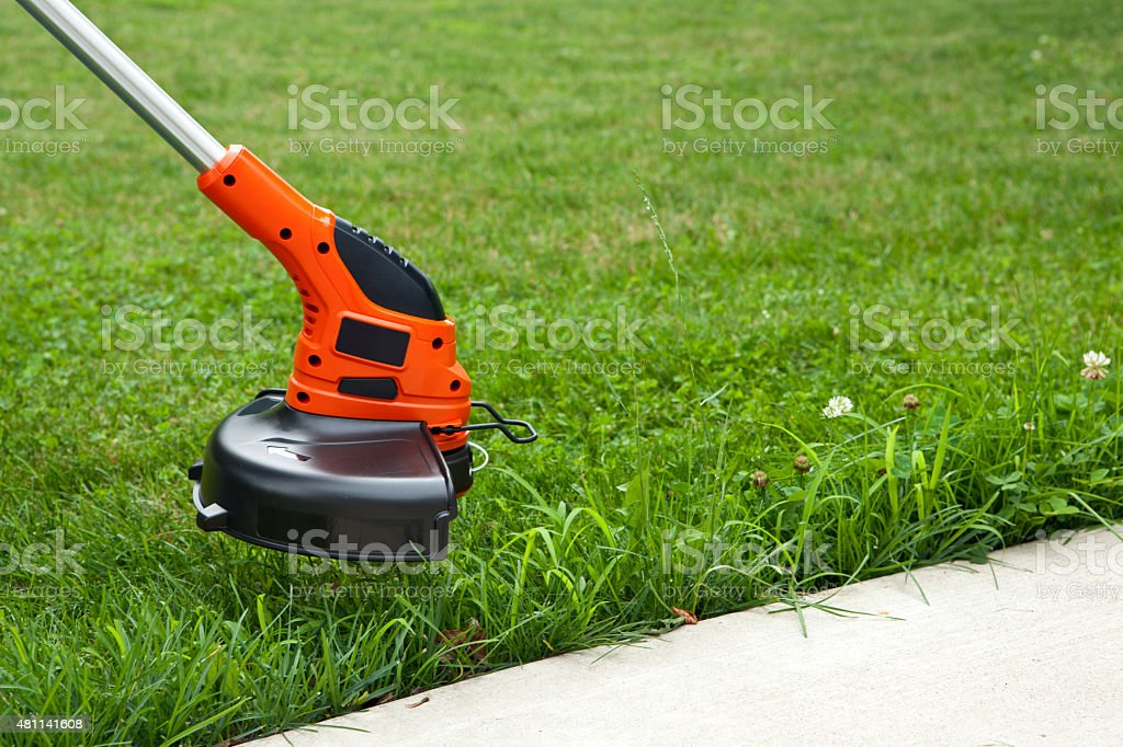 Trimming the Grass stock photo