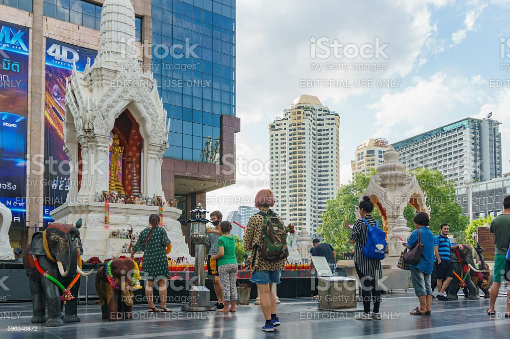 Trimurati buddha statue in front of central world plaza royalty-free stock photo