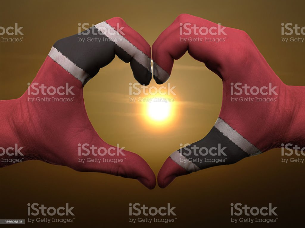 trinidad and tobago flag heart and love gesture and sunset stock photo