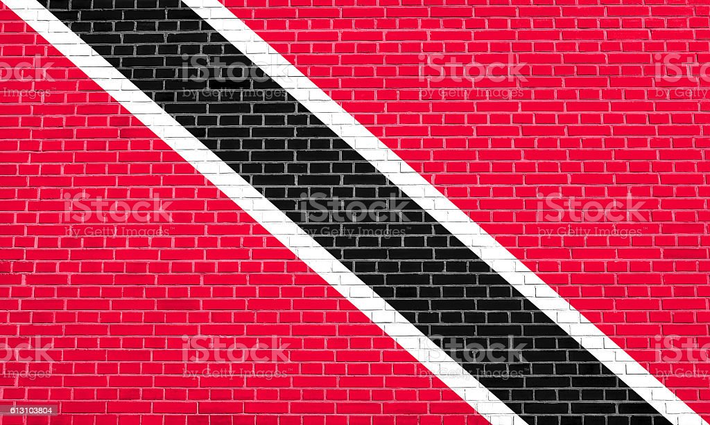 Trinidad and Tobago flag on brick wall texture stock photo