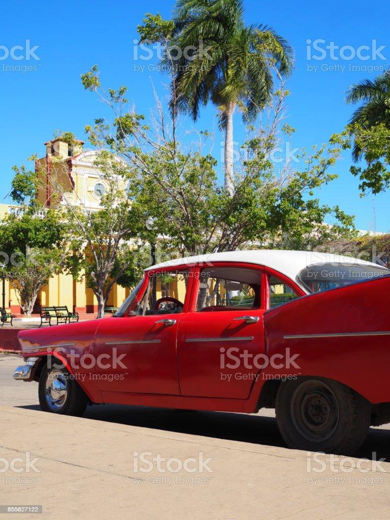 Beautiful rustic square and a car, Trinidad, Cuba