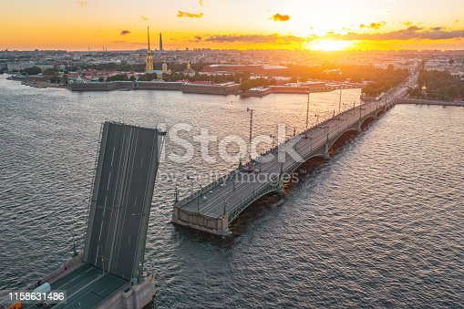 Trinity Bridge with a divorced state. Evening aerial view of the Peter and Paul Fortress at sunset