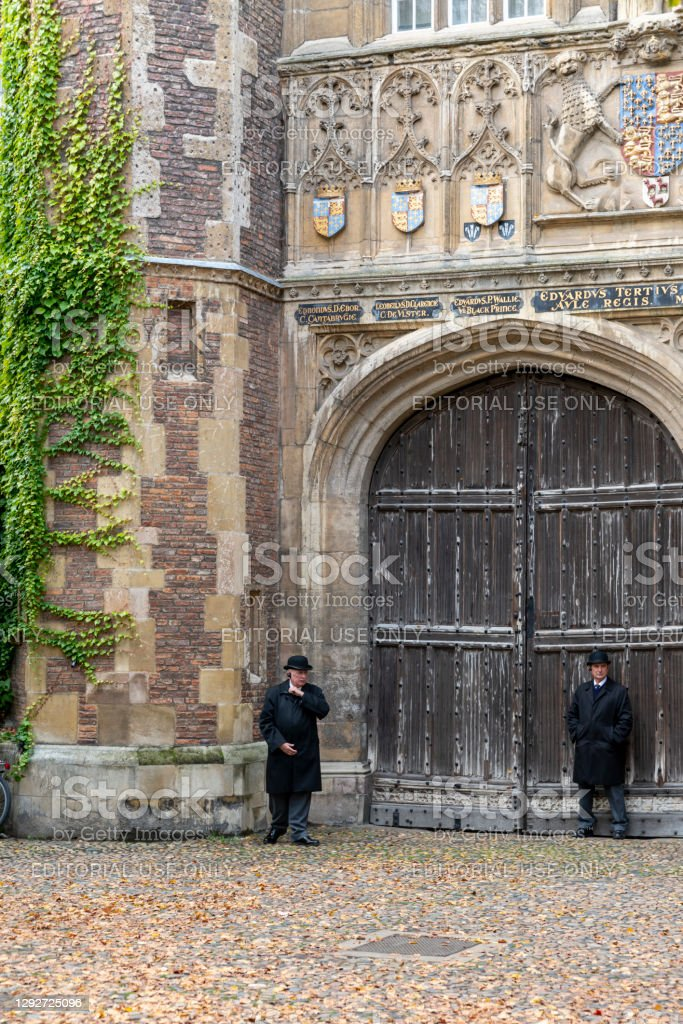 Trinity College Great Gate Trinity College Great Gate with tourists walking past. This is on Trinity Street, Cambridge, Cambridgeshire, England, UK. 2020 Stock Photo