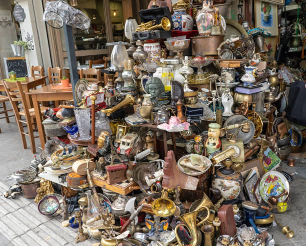 Trinkets for sale in the Monastiraki neighborhood in Athens, Greece Athens, Greece - October 19, 2018: A pile of trinkets and antiques for sale at a marketplace in the Monastiraki neighborhood, known for its antique shopping and flea markets. greed stock pictures, royalty-free photos & images