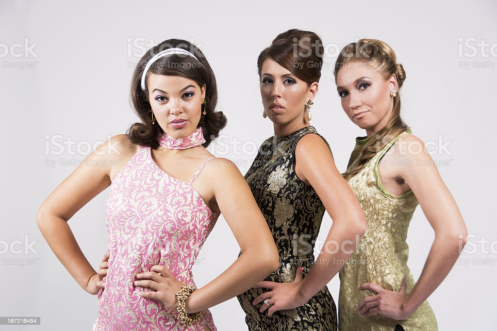 Trio of 60s styled women with attitude. royalty-free stock photo