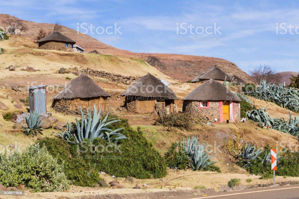 Trio of Basotho Huts stock photo
