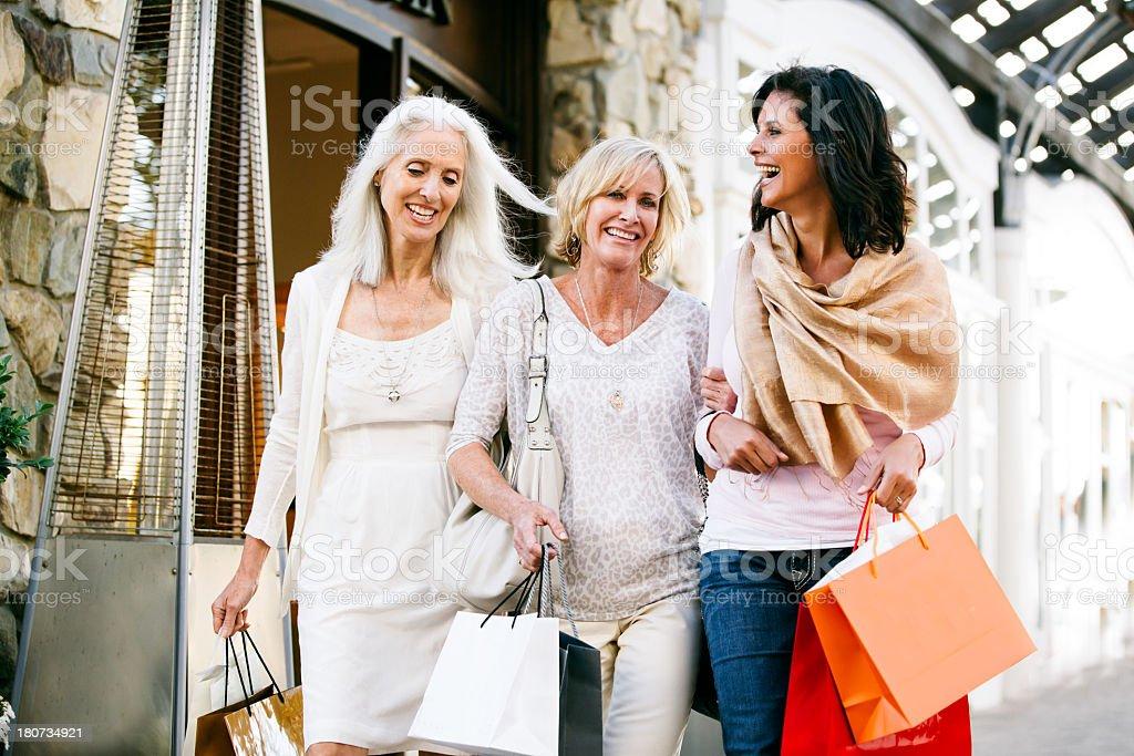 Trio of Beautiful mature women shopping stock photo