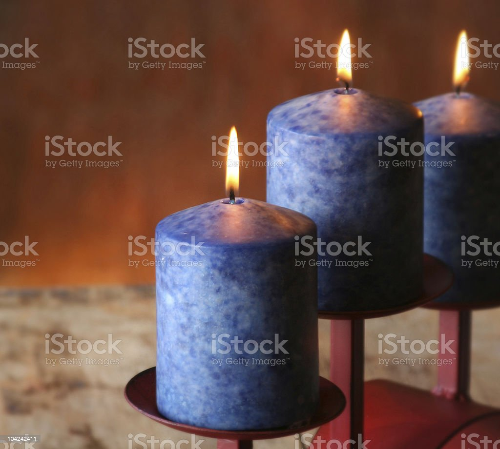 Trio of blue candles royalty-free stock photo