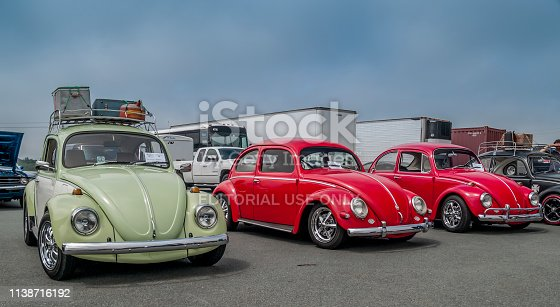Dartmouth, Nova Scotia, Canada - July 19, 2009: A trio of classic Volkswagen Beetles 1971 (green), 1956 (middle) and 1967 at 2009 Miller Tire Car Show in Burnside Industrial Park.
