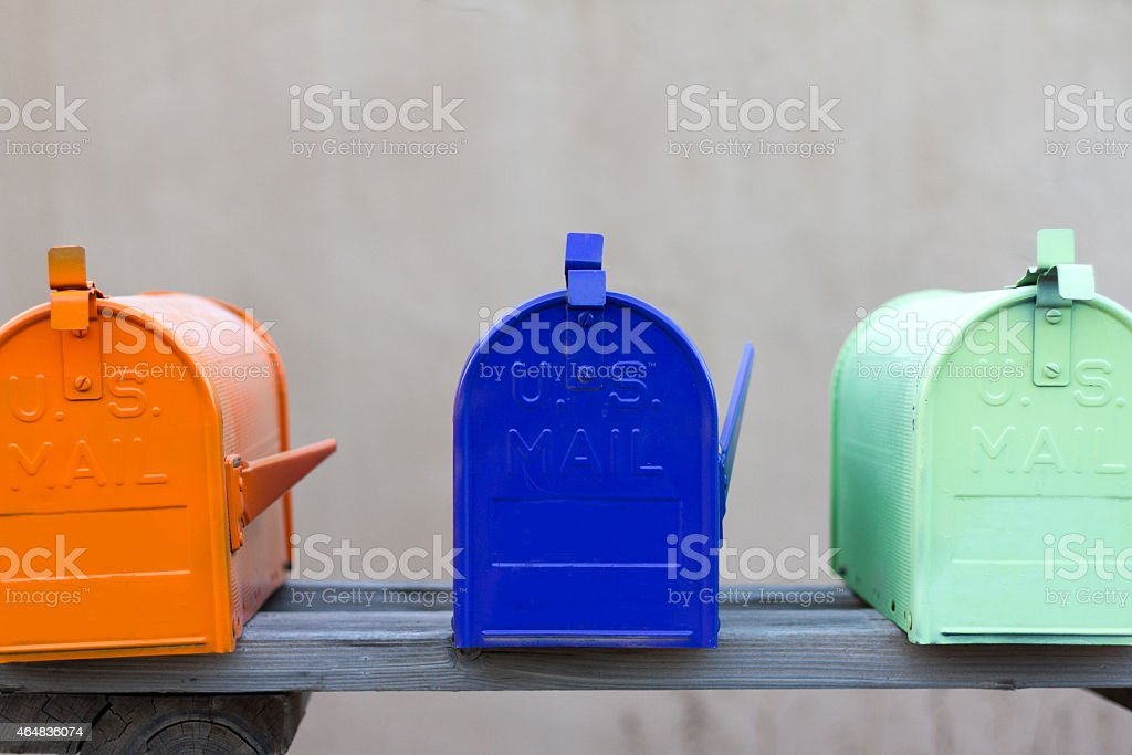 Trio of Colorful Rural Mailboxes stock photo
