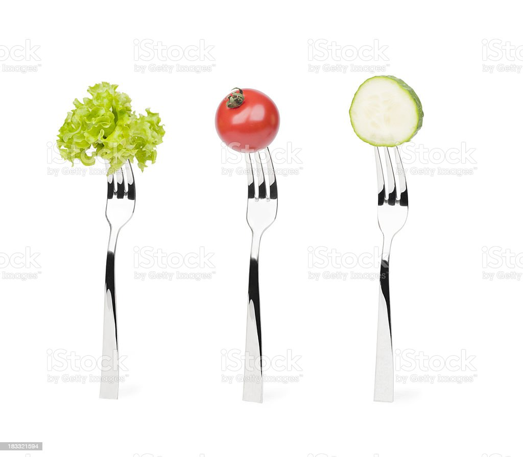 Trio of lettuce cucumber and tomato on forks royalty-free stock photo
