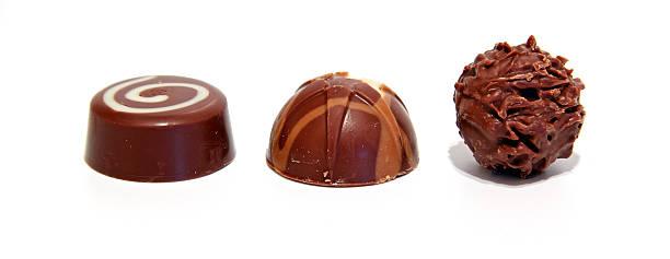 Trio of luxury milk chocolates lined up isolated stock photo