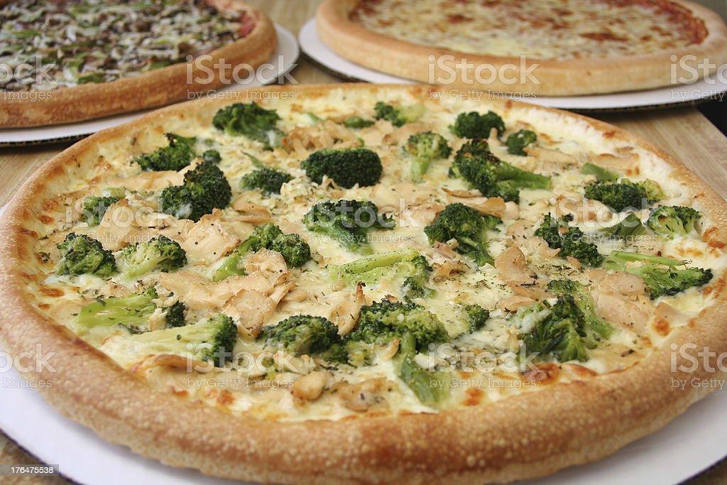 Trio of Pizzas stock photo
