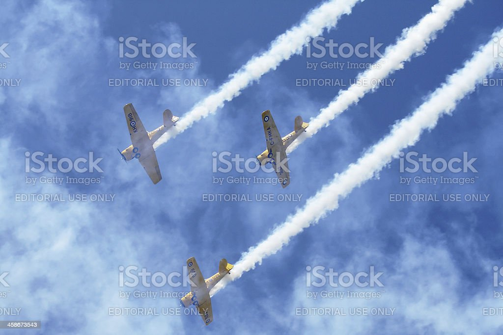Trio of WWII Canadian Harvard AT-6 Airplanes Diving in Formation royalty-free stock photo
