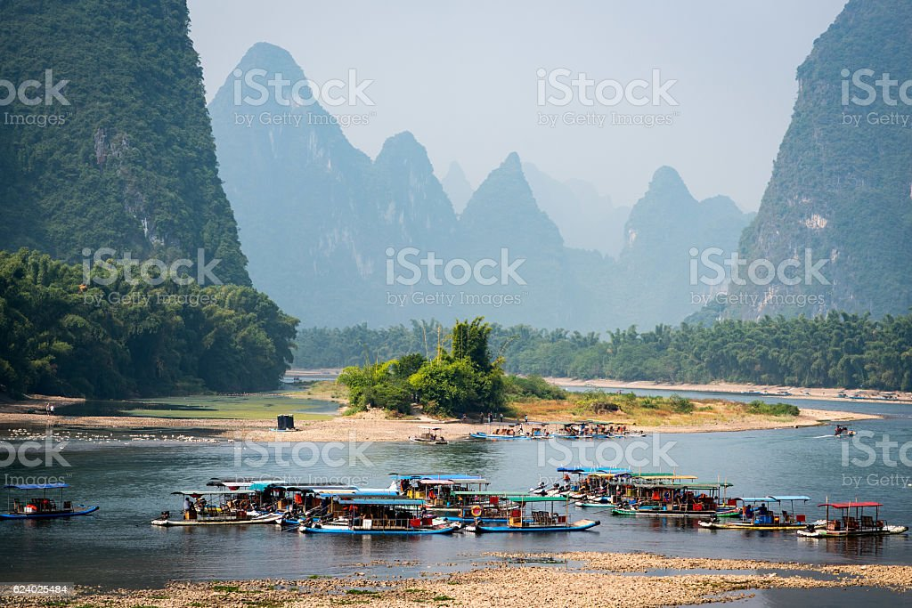 Trip boats lined up on Li river stock photo