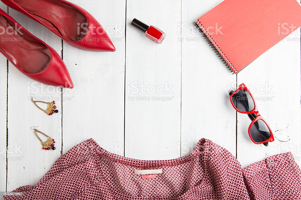 trip concept - set of woman stuff on wooden background stock photo